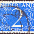 Royalty-Free Stock Photo: NETHERLANDS - CIRCA 1946: A stamp printed in the Netherlands shows it's value of 2 cent, circa 1946.