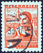 "AUSTRIA - CIRCA 1934: A stamp printed in Austria from the ""Costumes"" issue shows a woman from Burgenland, circa 1934. — Stock Photo"