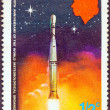 Постер, плакат: DOMINICA CIRCA 1973: A stamp printed in Dominica issued for the centenary of the World Meteorological Organization shows the launching of weather satellite circa 1973