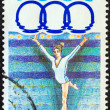 "GREECE - CIRCA 1991: A stamp printed in Greece from the ""11th Mediterranean Games, Athens"" issue shows balance beam gymnastics, circa 1991. — Stock Photo"
