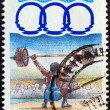 "GREECE - CIRCA 1991: A stamp printed in Greece from the ""11th Mediterranean Games, Athens"" issue shows weightlifting, circa 1991. — Stock Photo"