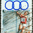 "GREECE - CIRCA 1991: A stamp printed in Greece from the ""11th Mediterranean Games, Athens"" issue shows hammer throw, circa 1991. — Stock Photo"