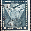 CHILE - CIRCA 1934: A stamp printed in Chile shows Fokker Super Universal Aircraft over Globe, circa 1934. — Stock Photo