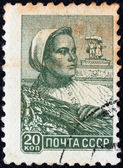 USSR - CIRCA 1958: A stamp printed in USSR shows a farm woman, circa 1958. — Stock Photo