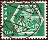 "SWITZERLAND - CIRCA 1973: A stamp printed in Switzerland from the ""Architecture and handicrafts"" issue shows a medallion from Saint Georgen Monastery, Stein am Rhein, circa 1973. — Stock Photo"