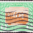 SUDAN - CIRCA 1951: A stamp printed in Sudan shows Saluka farming, circa 1951. - ストック写真