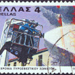 Stock Photo: GREECE - CIRC1980: stamp printed in Greece issued for 50th anniversary of fire brigade shows firefighting squad, circ1980.