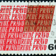 ZECHOSLOVAKIA - CIRCA 1967: A stamp printed in Czechoslovakia issued for the 50th anniversary of Rude Pravo (newspaper) shows Rude Pravo logo, circa 1967. - Stock Photo