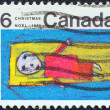 CANADA - CIRCA 1970: A stamp printed in Canada from the &amp;quot;Christmas. Children&amp;#039;s Drawings&amp;quot; issue shows Christ in Manger (J. McKinney), circa 1970. - Stock Photo