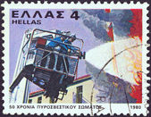 GREECE - CIRCA 1980: A stamp printed in Greece issued for the 50th anniversary of fire brigade shows a firefighting squad, circa 1980. — Stock Photo