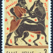 "GREECE - CIRCA 1970: A stamp printed in Greece from the ''Hercules"" issue shows Hercules killing centaur Nessus, circa 1970. - Stock Photo"