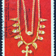 CYPRUS - CIRCA 1976: A stamp printed in Cyprus shows a gold necklace from 6th century AD found in Cyprus and now exposed in Metropolitan museum New York, circa 1976. - Stock Photo