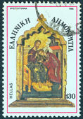 "GREECE - CIRCA 1986: A stamp printed in Greece from the ""Christmas"" issue shows a hagiography, circa 1986. — Stock Photo"