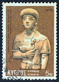 CYPRUS - CIRCA 1976: A stamp printed in Cyprus shows a terracotta from 7th century BC found in Cyprus and now exposed in Medelhavmuseet museum Stockholm, circa 1976. — ストック写真