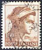 """ITALY - CIRCA 1961: A stamp printed in Italy from """"Michelangelo"""" issue shows a head of the """"Ignudi"""" from Sistine Chapel, circa 1961. — Stock Photo"""
