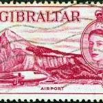 GIBRALTAR - CIRCA 1953: A stamp printed in Gibraltar shows Airport, Gibraltar and Queen Elizabeth II, circa 1953. — Stock Photo #14534683