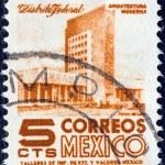MEXICO - CIRCA 1950: A stamp printed in Mexico shows modern building, Mexico City, circa 1950. — Stock Photo #14534569