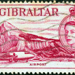 Stock Photo: GIBRALTAR - CIRC1953: stamp printed in Gibraltar shows Airport, Gibraltar and Queen Elizabeth II, circ1953.