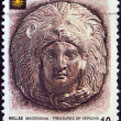 "GREECE - CIRCA 1992: A stamp printed in Greece from the ""Macedonia"" issue shows head of Hercules wearing lion skin, Vergina treasures, circa 1992. — Stock Photo"