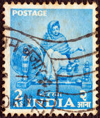 """INDIA - CIRCA 1955: A stamp printed in India from the """"Five Year Plan"""" issue shows a woman spinning, circa 1955. — Stock Photo"""