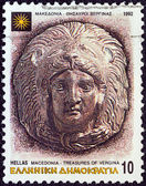"""GREECE - CIRCA 1992: A stamp printed in Greece from the """"Macedonia"""" issue shows head of Hercules wearing lion skin, Vergina treasures, circa 1992. — Stock Photo"""
