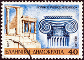 "GREECE - CIRCA 1987: A stamp printed in Greece from the ""Classical Architecture Capitals"" issue, shows Ionic capital and the Erechtheum, circa 1987. — Stock Photo"