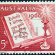 "AUSTRALIA - CIRCA 1960: A stamp printed in Australia from the ""Christmas"" issue shows Open Bible and Candle, circa 1960. — Stock Photo"