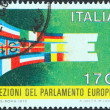 ITALY - CIRC1979: stamp printed in Italy issued for first direct elections to EuropeParliament shows Flags of Member States forming E, circ1979. — Stock Photo #14866027