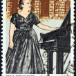 GREECE - CIRCA 1981: A stamp printed in Greece issued for her 5th death anniversary shows famous pianist Gina Bachauer, circa 1981. — Stock Photo