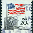 USA - CIRCA 1981: A stamp printed in USA shows Flag over Supreme Court, circa 1981. - Stock Photo