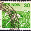 Royalty-Free Stock Photo: INDIA - CIRCA 1979: A stamp printed in India shows maize harvesting, circa 1979.