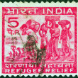 Stock Photo: INDI- CIRC1971: stamp printed in Indiissued for refugee relief shows refugees from East Pakistan, circ1971.