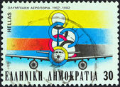 GREECE - CIRCA 1982: A stamp printed in Greece issued for the 25th anniversary of Olympic Airways shows Airbus A300 airliner and emblem, circa 1982. — 图库照片
