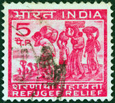 INDIA - CIRCA 1971: A stamp printed in India issued for refugee relief shows refugees from East Pakistan, circa 1971. — Stock Photo
