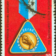 GREECE - CIRCA 1969: A stamp printed in Greece issued for the 9th European Athletics Championships, Athens shows a gold medal, circa 1969. — Stock Photo