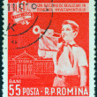 ROMANIA - CIRCA 1958: A stamp printed in Romania issued for the 10th anniversary of education reform shows a boy bugler, circa 1958. — Lizenzfreies Foto