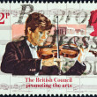 Stock Photo: UNITED KINGDOM - CIRCA 1984: A stamp printed in United Kingdom issued for the 50th anniversary of British Council shows a violinist and Acropolis, Athens, circa 1984.