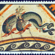 "GREECE - CIRCA 1970: A stamp printed in Greece from the ""Greek Mosaics"" issue shows a Dolphin Mosaic, Delos island (110 B.C.), circa 1970. - Stock Photo"