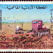 Royalty-Free Stock Photo: JORDAN - CIRCA 1973: A stamp printed in Jordan shows a farmer and a plowing machine, circa 1973.