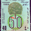 Royalty-Free Stock Photo: JORDAN - CIRCA 1989: A stamp printed in Jordan issued for the 50th anniversary of the Ministry of Agriculture shows a tree and emblem, circa 1989.