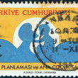 """TURKEY - CIRCA 1983: A stamp printed in Turkey from the """"Family planning and mother and child health"""" issue shows mother and child silhouette, circa 1983. — Stock Photo"""