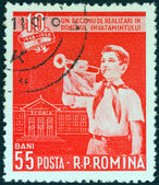 ROMANIA - CIRCA 1958: A stamp printed in Romania issued for the 10th anniversary of education reform shows a boy bugler, circa 1958. — Stock Photo
