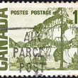 "CANADA - CIRCA 1967: A stamp printed in Canada from the ""Centennial"" issue shows ""The Jack Pine"" painting by Tom Thomson, circa 1967. — Stock Photo #15640851"