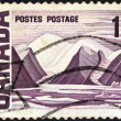 "CANADA - CIRCA 1967: A stamp printed in Canada from the ""Centennial"" issue shows ""Bylot Island"" painting by Lawren Harris, circa 1967. — Stock Photo #15640913"