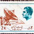 Stock Photo: IRAN - CIRC1975: stamp printed in Irshows Mohammad RezPahlavi (last Shah) and earth telecommunication station, circ1975.