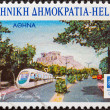 "GREECE - CIRCA 2004: A stamp printed in Greece from the ""Cities hosting Olympic events"" issue shows Athens (a tram and Acropolis), circa 2004. — Stock Photo"