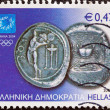 "GREECE - CIRCA 2004: A stamp printed in Greece from the ""Athens Olympic games 2004: Ancient coins"" issue shows a silver 3-drachma coin of Cos island, circa 2004. — Stock Photo"