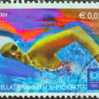 "GREECE - CIRCA 2004: A stamp printed in Greece from the ""Olympic Games, Athens"" issue shows a swimmer, circa 2004. — Stock Photo"