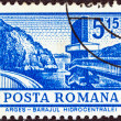 "ROMANIA - CIRCA 1972: A stamp printed in Romania from the ""Definitives I - Buildings"" shows a Hydro-electric power station, Arges, circa 1972. — Stock Photo"