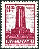 """ROMANIA - CIRCA 1972: A stamp printed in Romania from the """"Definitives I - Buildings"""" shows Heroes Monument, Bucharest, circa 1972. — Stock Photo"""
